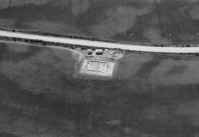 Oblique aerial view centred on the excavation of the timber hall at Balbridie, looking to the S.