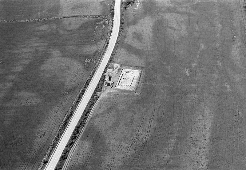 Oblique aerial view centred on the excavation of the timber hall at Balbridie, looking to the W.