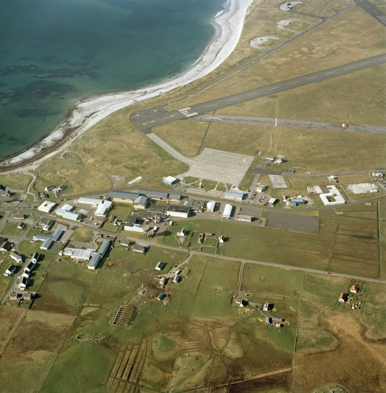 Oblique aerial view centred on Balivanich village with Benbecula airfield adjacent, taken from the S.
