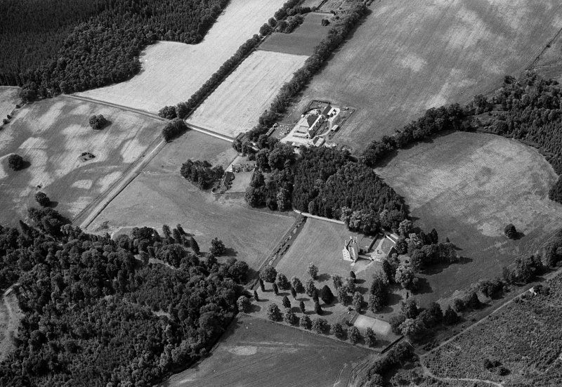 Oblique aerial view centred on Aboyne Castle and Policies, looking to the SW.