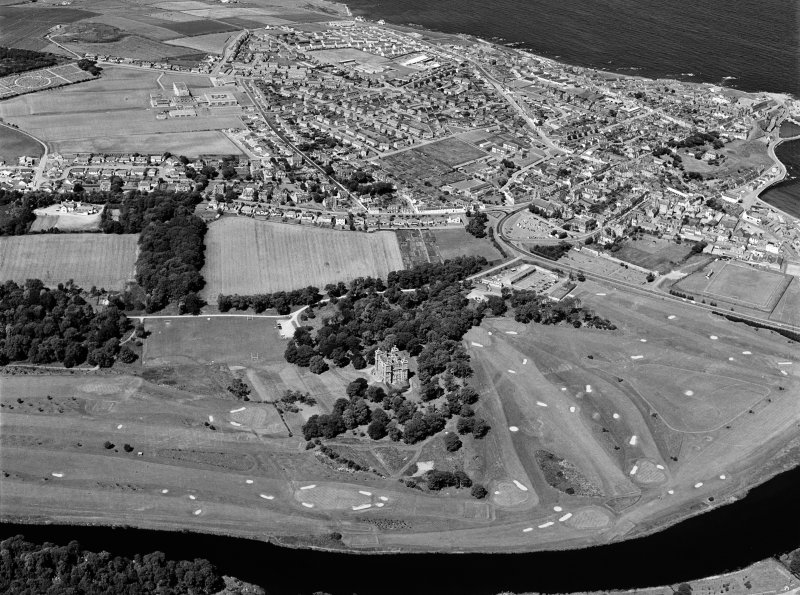 Oblique aerial view centred on Duff House with the golf course adjacent, looking to the NW.