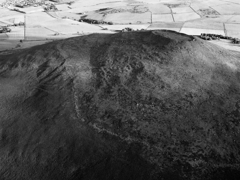 Oblique aerial view centred on the remains of the vitrified fort at Tap O' Noth, looking to the S.