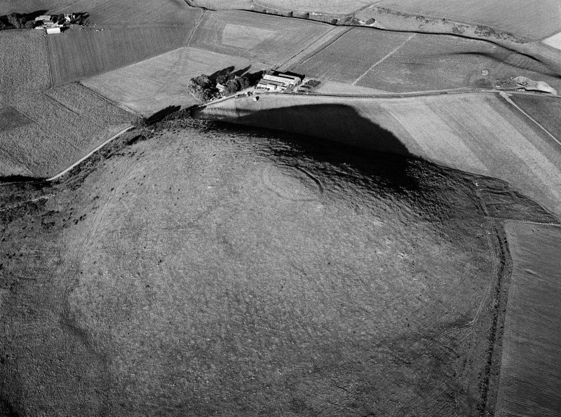 Oblique aerial view centred on the remains of the fort at Wheedlemont, looking to the E.