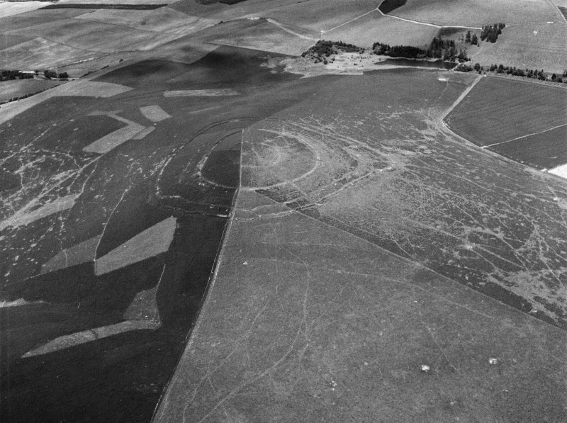Oblique aerial view centred on the remains of the fort at Brown Caterthun, looking to the N.