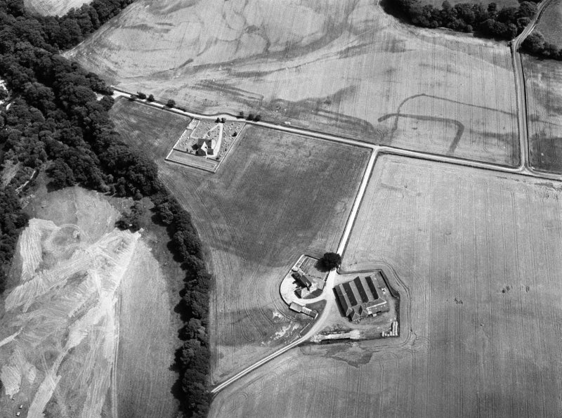 Oblique aerial view centred on the cropmarks of the Roman Temporary Camp, ring ditch and pits with Strathcathro Parish Church adjacent, looking to the E.