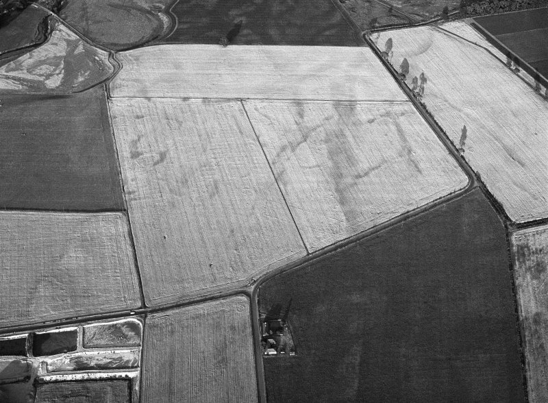 Oblique aerial view of the cropmarks of the pit defined cursus, enclosed cremation cemetery, rectilinear enclosure, ring ditch and rig at Balneaves, looking to the E.