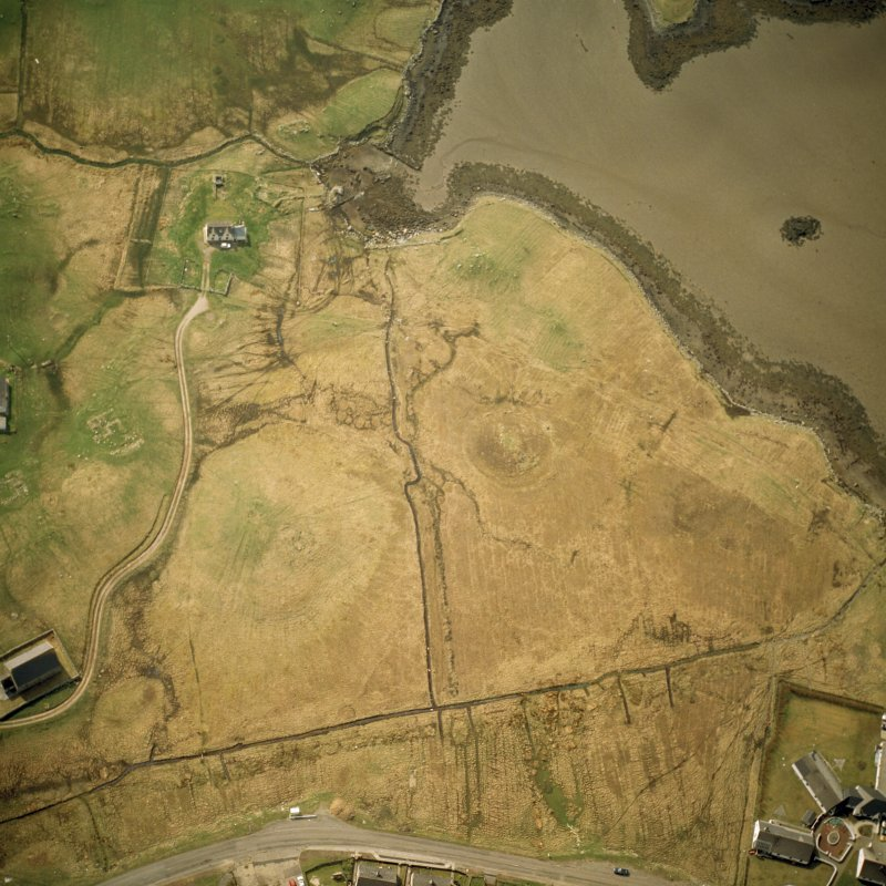 Oblique aerial view centred on the remains of the cairns, taken from the ENE.