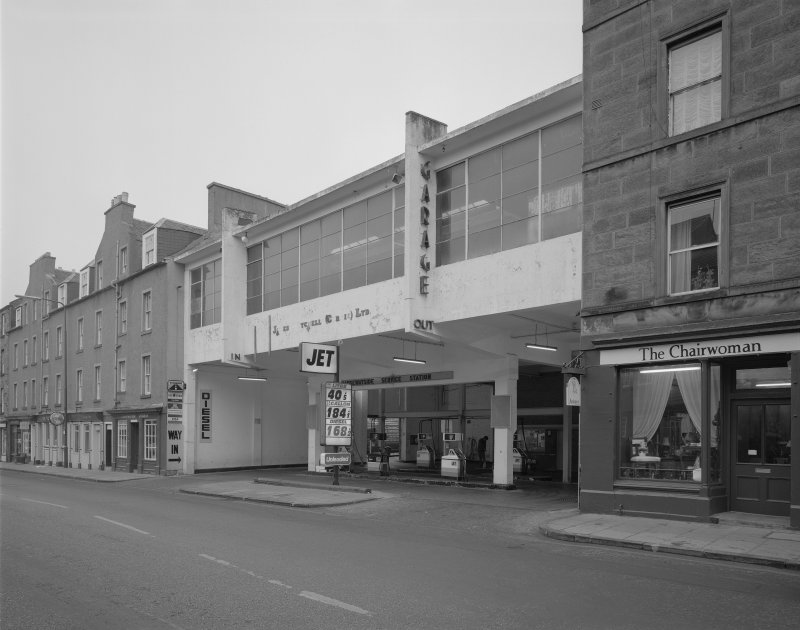 Scanned copy of general view of the front of the garage from the South West, in use as a filling station with the upper floor in disrepair.