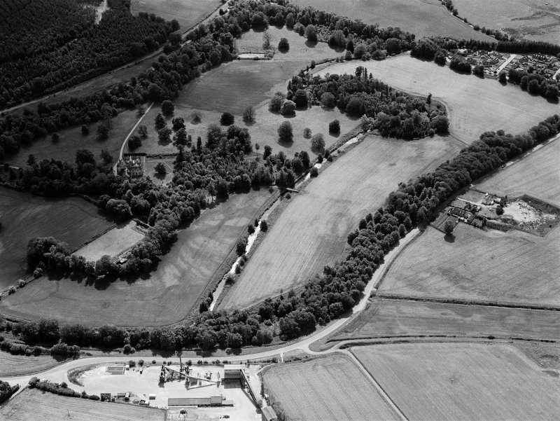 General oblique aerial view of Pitcaple Castle with the cropmarks adjacent, looking to the SW.