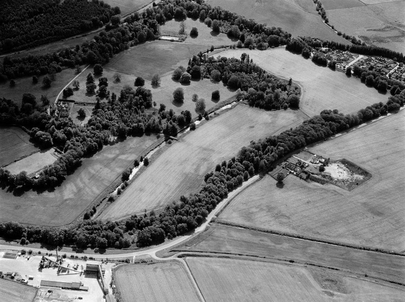 General oblique aerial view of Pitcaple Castle with the cropmarks adjacent, looking to the SSW.