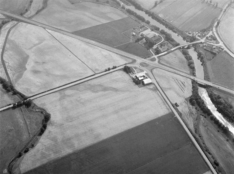 Oblique aerial view centred on North Water Bridge and the A90, looking to the SE.