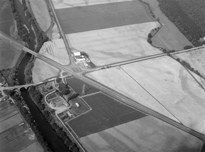 Oblique aerial view centred on North Water Bridge and the A90, looking to the WNW.