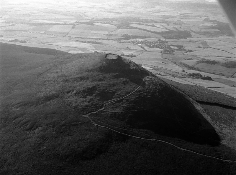 Oblique aerial view centred on the remains of the vitrified fort at Tap O' Noth, looking to the ESE.