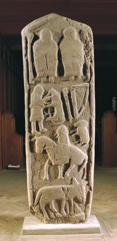 View of reverse of the Aldbar cross-slab, displaying seated figures, David wrestling with the lion, harp, ram, a horseman, and  indeterminate animal. Brechin Cathedral.