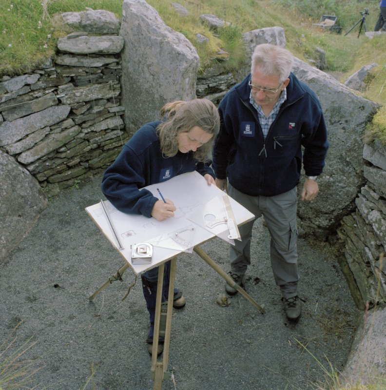 Survey in progress: Mr Alan Leith and Ms Georgina Brown (Both RCAHMS) in picture. Digital copy of photograph.