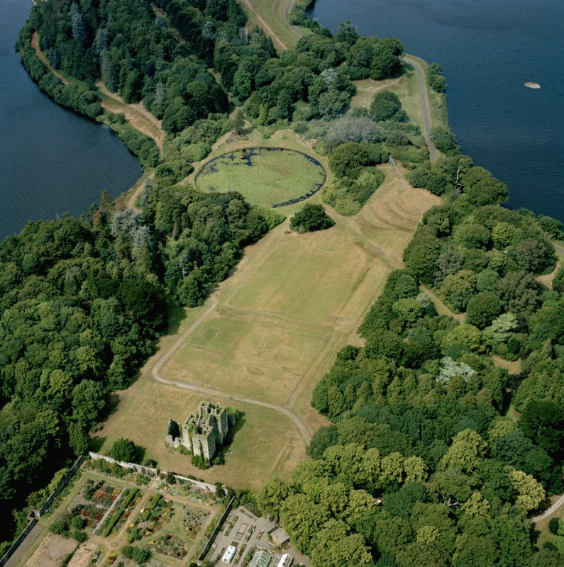 Oblique aerial view of Castle Kennedy showing cropmarks of former garden.
