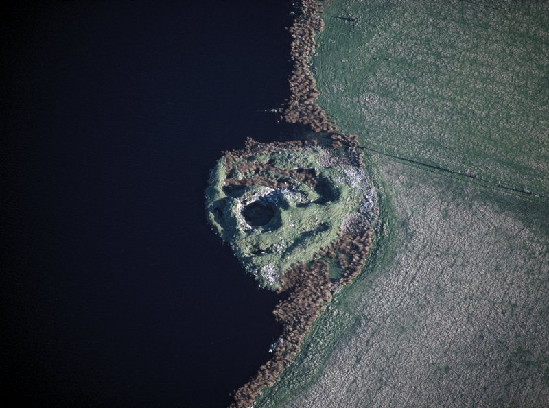 Oblique aerial view centred on the broch and outbuildings.