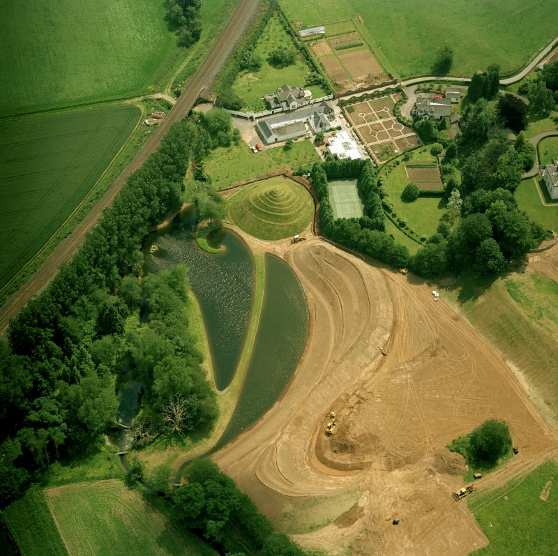 Oblique aerial view centred on Portrack House and garden.