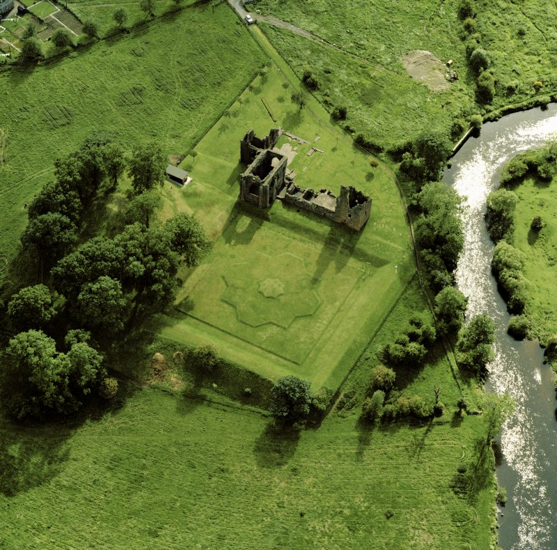 Oblique aerial view of Lincluden church and nunnery showing former garden earthworks.