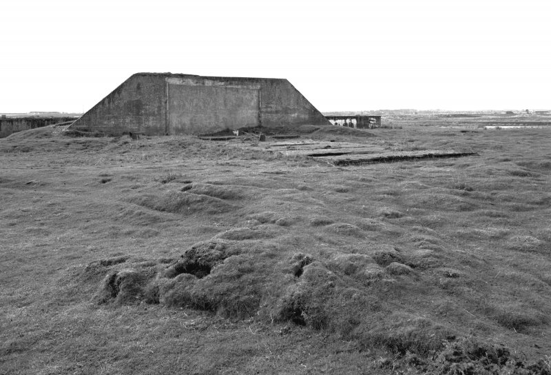 Tain Airfield Tracked Target Range, view from NW showing relationship between target vehicle shed and protective anti-blast wall.