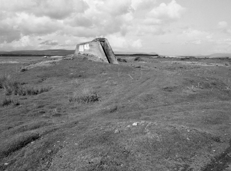 Tain Airfield tracked target range. View from SE showing N wall protecting building for tracked target vehicle.