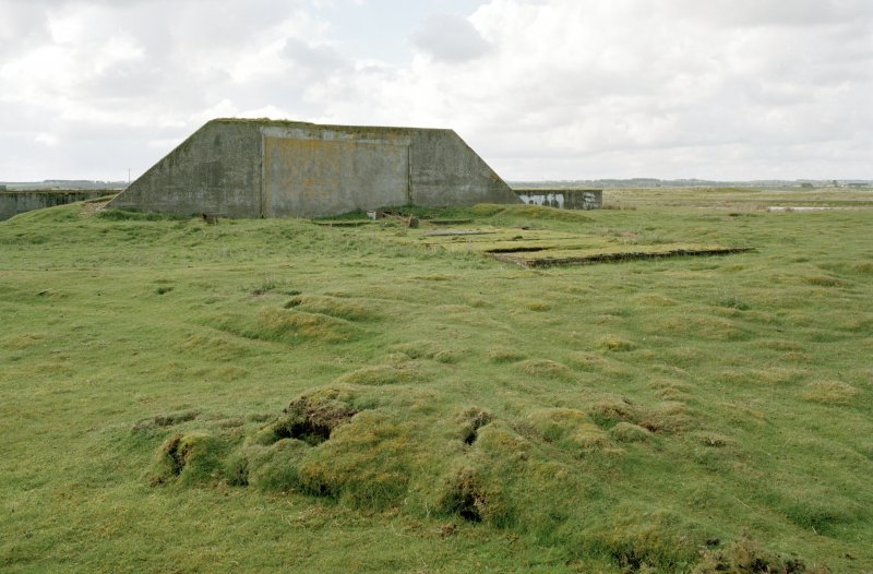 Tain Arfield Tracked Target Range, view from NE showing relationship between traget vehicle shed and protective anti-blast wall.