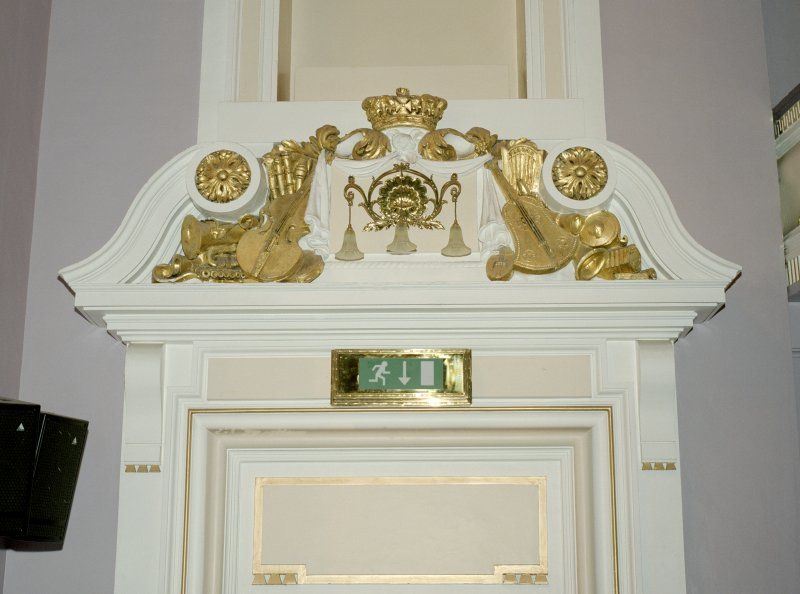 Interior view of Usher Hall, Edinburgh. Auditorium, detail of pediment above door at front of stalls