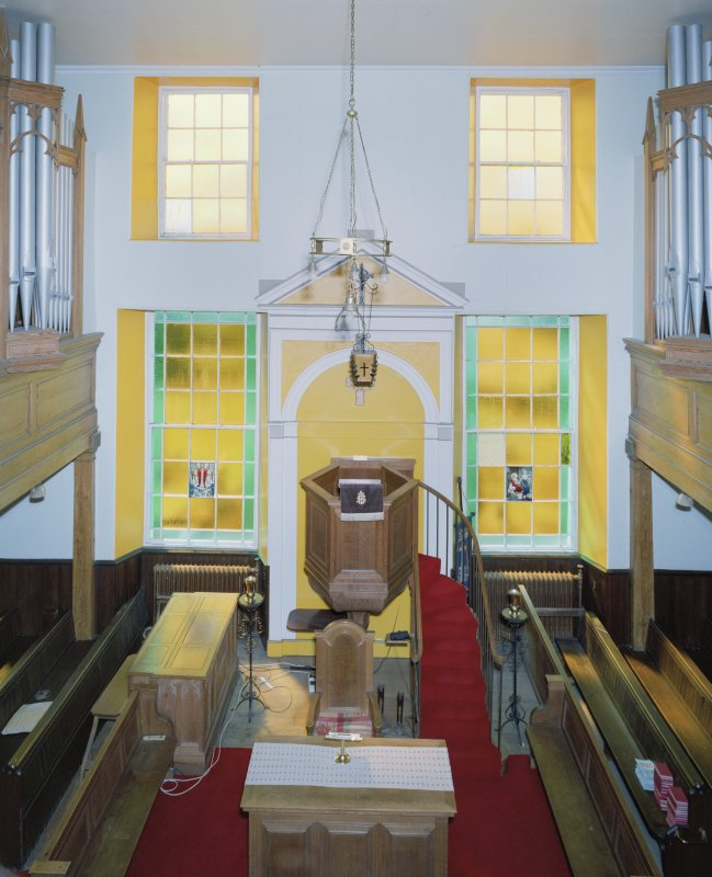 Interior. View from N at gallery level axial view of pulpit and both sets of organ pipes