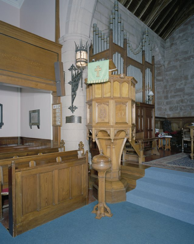 Interior. Detail of pulpit and font