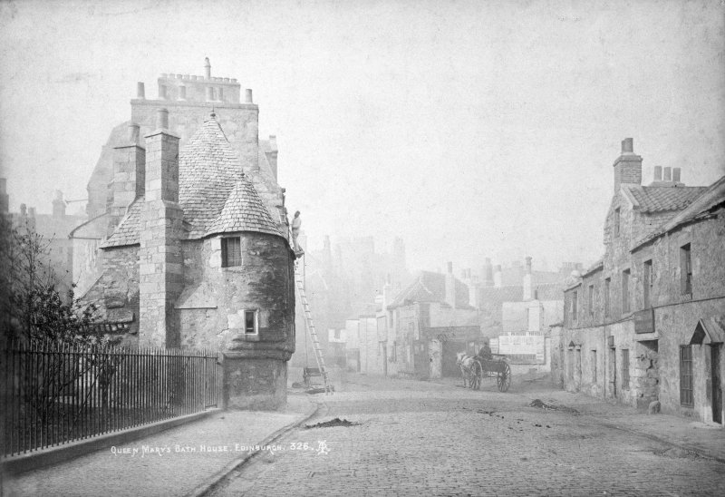 "Copy of photograph showing general view of Queen Mary's Bath House from North, with man up a ladder, also showing houses in Abbeyhill with horse and cart in centre Insc. ""Queen Mary's Bath-House, Edinburgh. 326. A.I."""