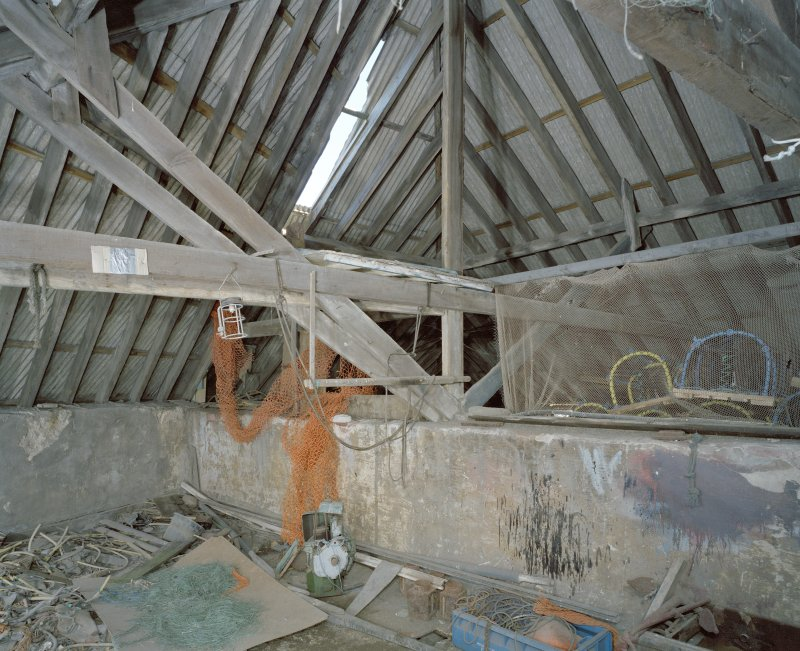 Interior. Top floor. Roof structure and central wall.