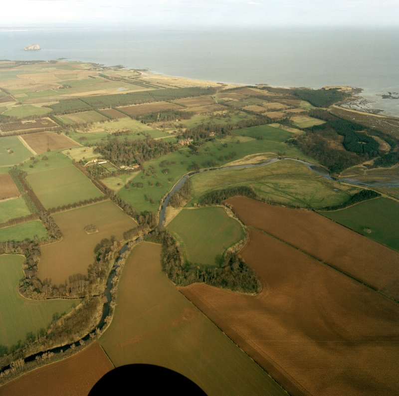 Oblique aerial view of the country house and policies, taken from the SSW.