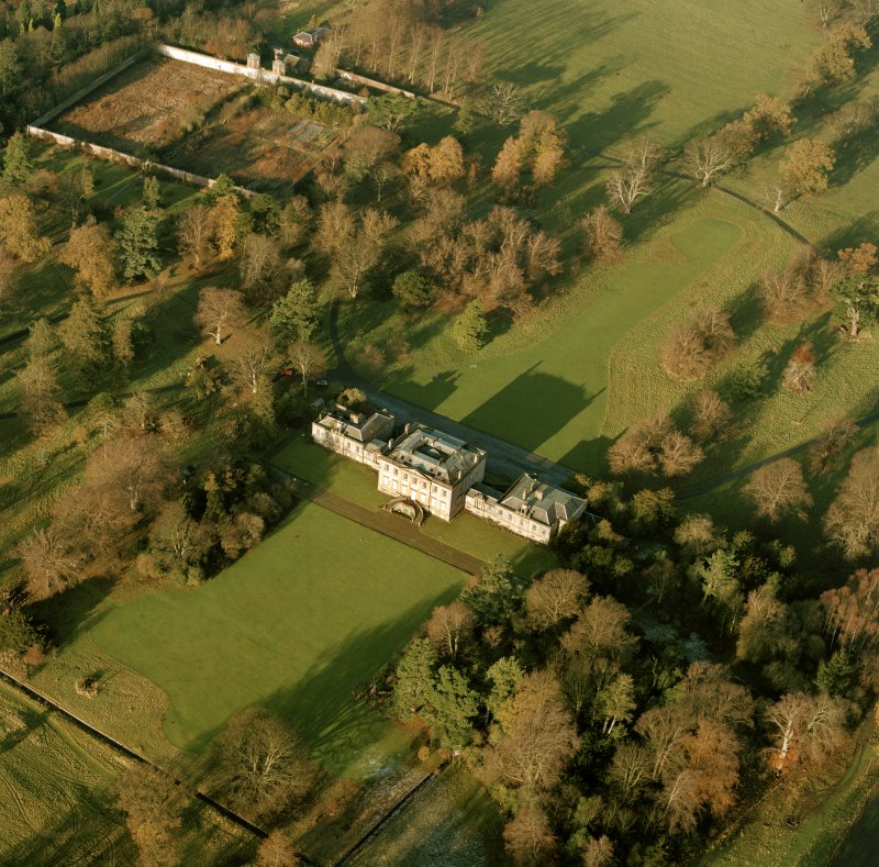 Oblique aerial view, taken from the SW, centred on the country house with the formal garden in the top left-hand corner of the photograph.