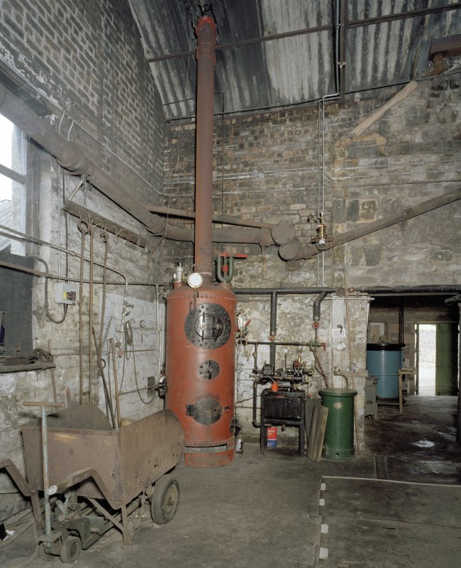 Interior. Retort House: view from SW looking towards coal store beyond (former retort house, c.1839) and artefacts. Note the outline of the eformer exterior S wall of the former retort house to the right of the picture