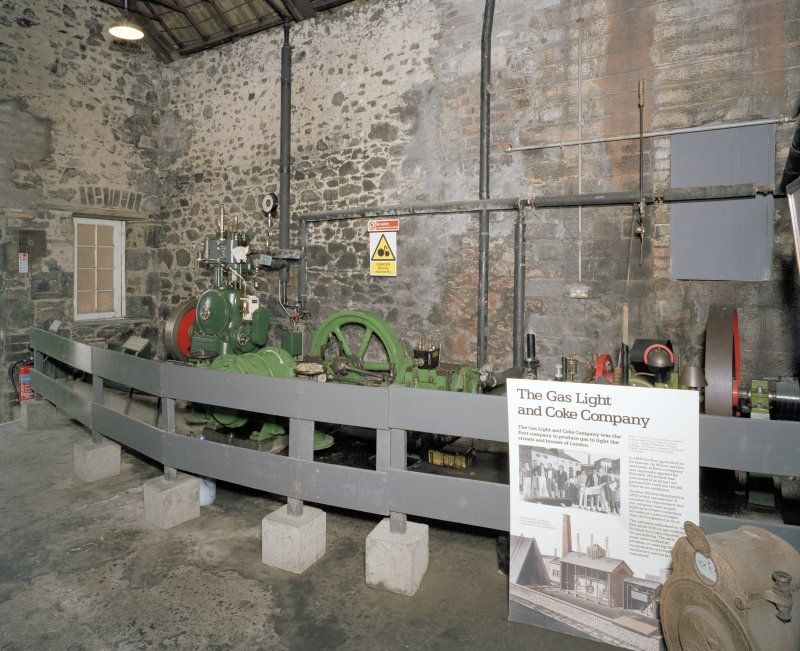 Interior. Coal Store: View of the former retort house and coal store in use as an exhibition space, and various artefacts brought from other sites. Sisson high speed engine to left and waller exhauster and steam engine in middle of image