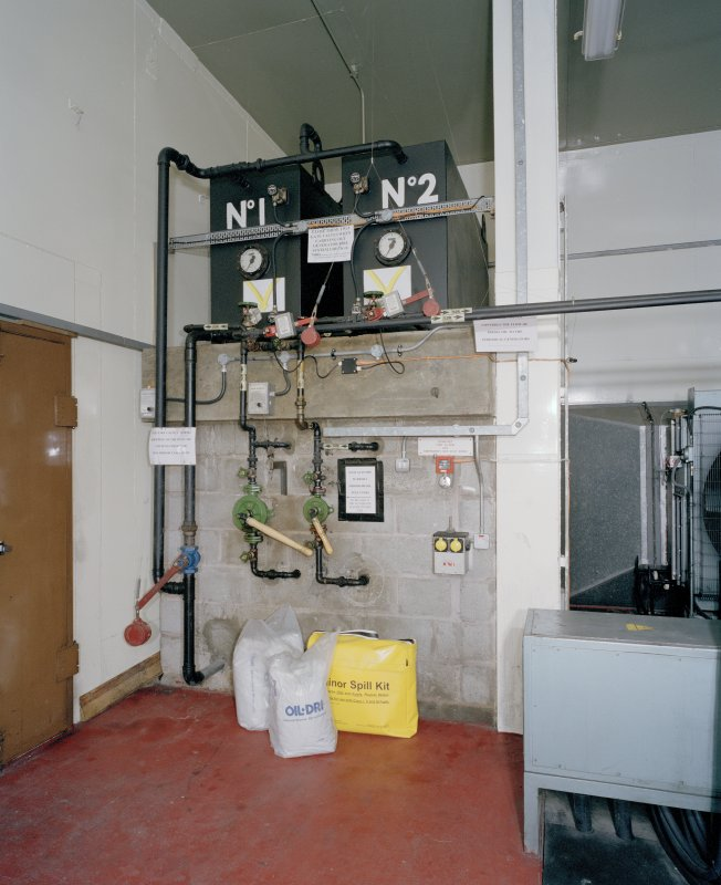 Interior. View of pump and control panel for oil supply to emergency power No.1 and No.2 diesel engines.