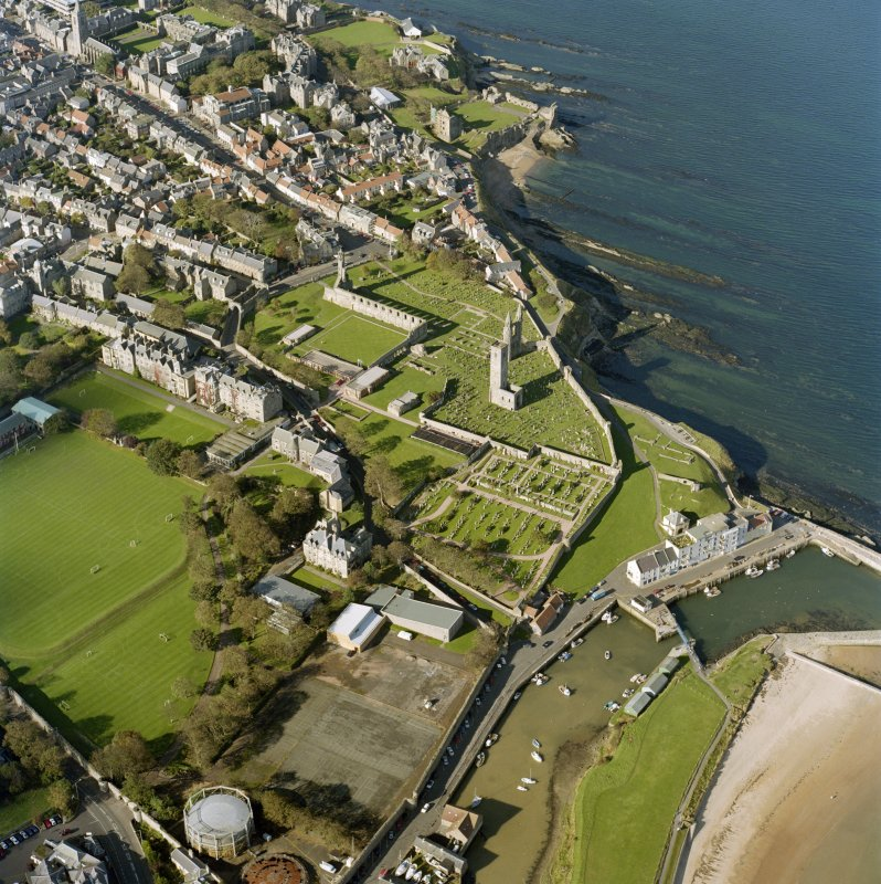 Oblique aerial view centred on the remains of St Andrews cathedral and burial-ground, taken from the SE.
