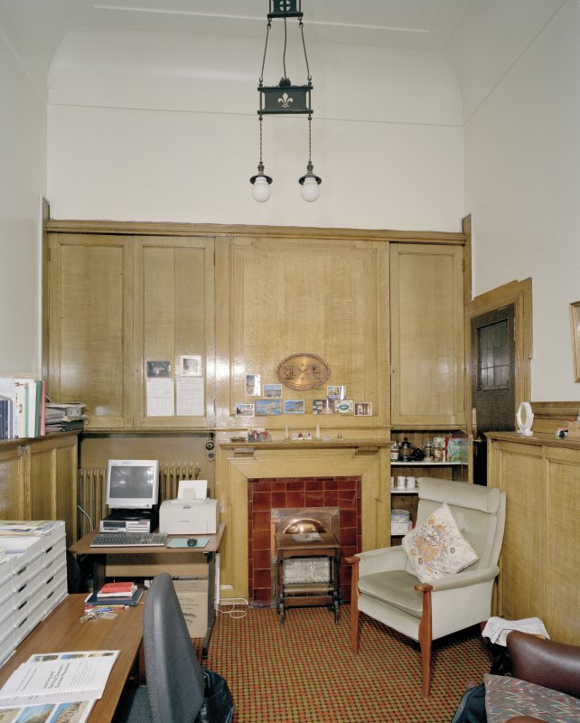 Interior. Chaplain's Office including original light fitting and fireplace