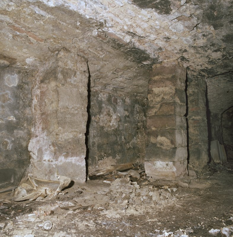 Scanned image of Interior.  Detail of stone pillars and stub wall.