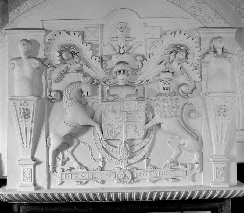 Interior, first floor, main hall, detail of plaster panel above fireplace.