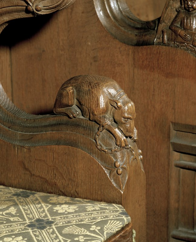 Thistle Chapel, interior, detail of carved figure on arm of seat.
