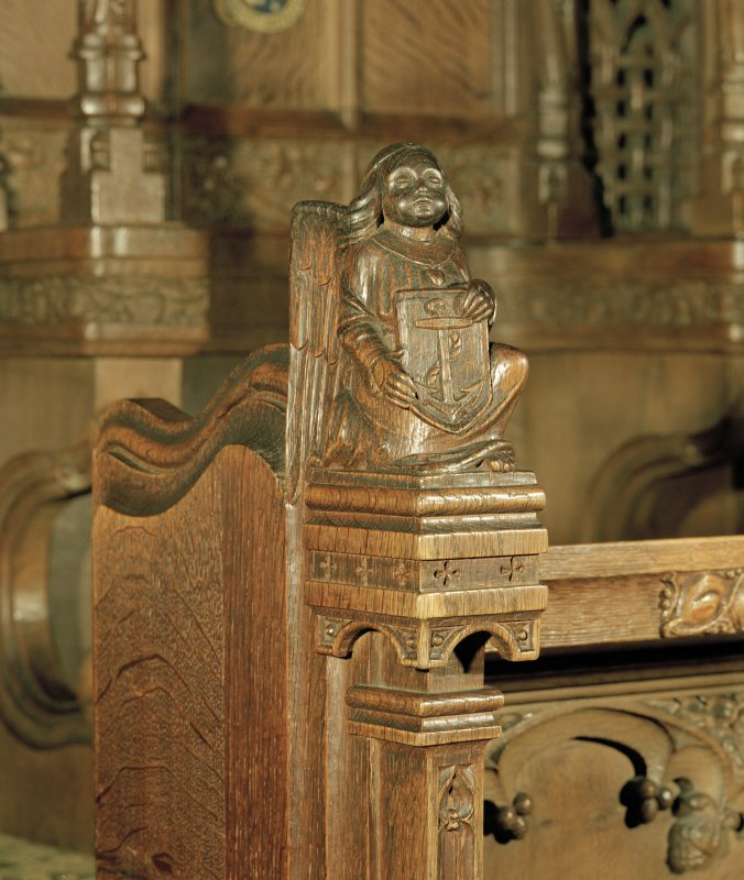 Thistle Chapel, interior, detail of carved angel at end of stalls.