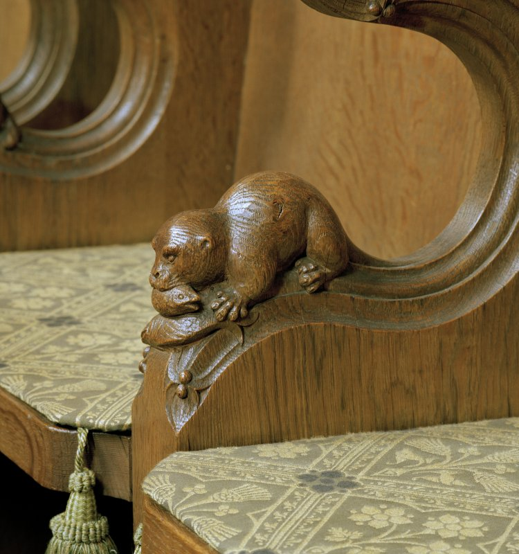 Interior of Thistle Chapel, showing detail of carved otter with fish on arm of stall.