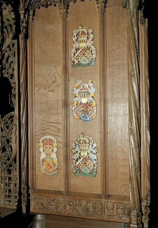 Thistle Chapel. interior, detail of selection of enamel plaques on back of seat.