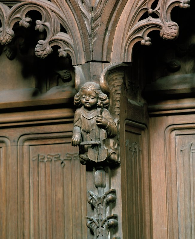 Interior view of the Thistle Chapel, Edinburgh, showing detail of carved angel playing violin, to west of main door.