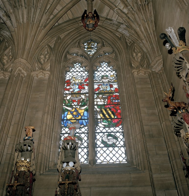 Thistle Chapel, interior view of crest with stained glass window behind.