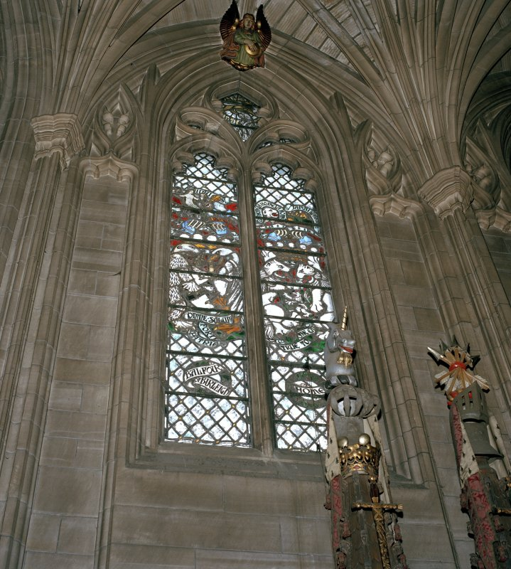 Thistle Chapel, interior view of crests with stained glass behind.