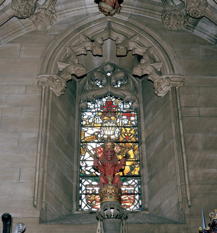 Thistle Chapel, interior, view of crest with stained glass window behind.