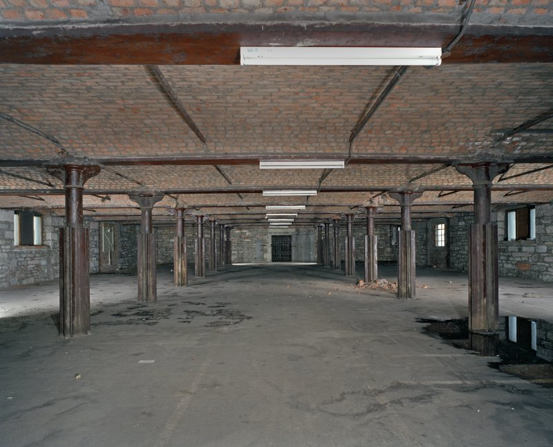 Interior.  3rd floor. General view from W showing cast-iron columns with paired double flanges. These flanges allowed the insertion of space dividers in order to store loose material like grain. The 2nd floor mirrors the 3rd floor.