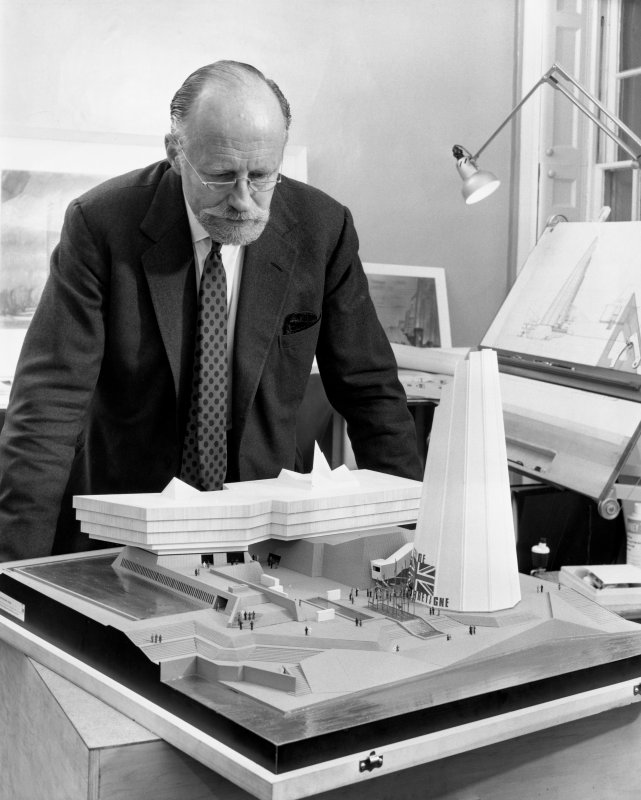 View of Sir Basil Spence studying the model of the British Pavilion for Expo 67.
